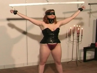 Busty redhead tied and blindfolded by her master