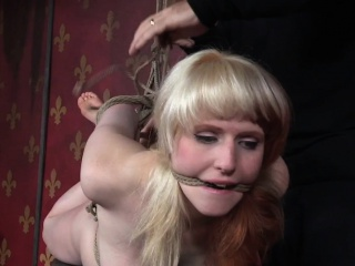 Ballgagged hogtied slut gets tormented