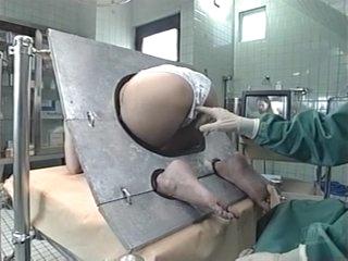 Hot milf is a Japanese AV Model in bondage for ass insertion